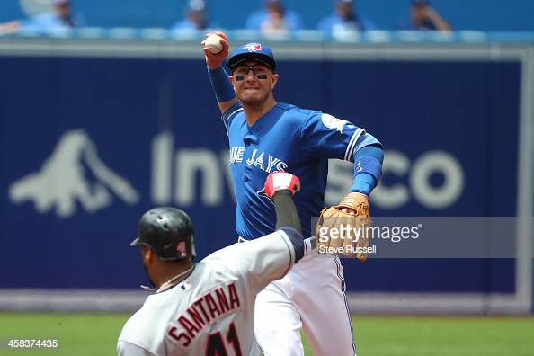 TORONTO ON JULY 2 Toronto Blue Jays shortstop Troy Tulowitzki turns a double play with Carlos Santana sliding in as the Toronto Blue Jays play the...