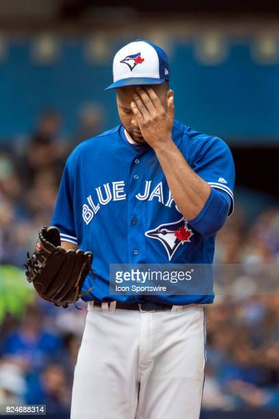 Toronto Blue Jays Starting pitcher Francisco Liriano wipes sweat from his brow on the mound during the regular season MLB game between the Los...
