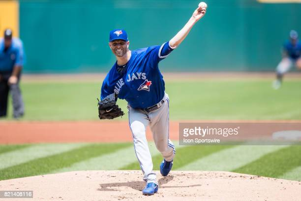 Toronto Blue Jays starting pitcher JA Happ delivers a pitch to the plate during the first inning of the Major League Baseball game between the...