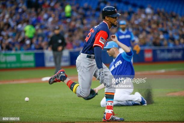 Toronto Blue Jays starting pitcher JA Happ misplays a ball allowing the Minnesota Twins center fielder Byron Buxton to reach 1st safely and the...