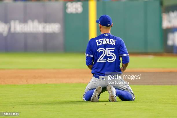 Toronto Blue Jays Starting pitcher Marco Estrada reacts after diving for a ground ball and missing during the MLB game between the Toronto Blue Jays...