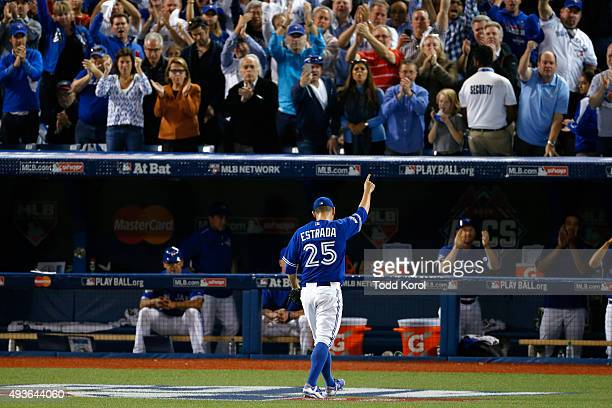 Toronto Blue Jays starting pitcher Marco Estrada single to the crowd after getting pulled in the eight inning against the Kansas City Royals in Game...