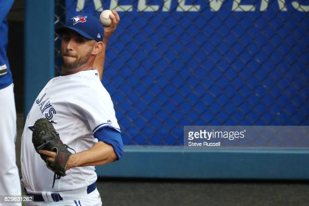 TORONTO ON AUGUST 10 Toronto Blue Jays starting pitcher Marco Estrada warms up before the game as the Toronto Blue Jays shutout the New York Yankees...