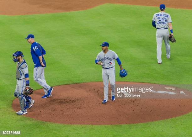 Toronto Blue Jays starting pitcher Marcus Stroman resumes pitching after meeting with teammates during the MLB game between the Toronto Blue Jays and...