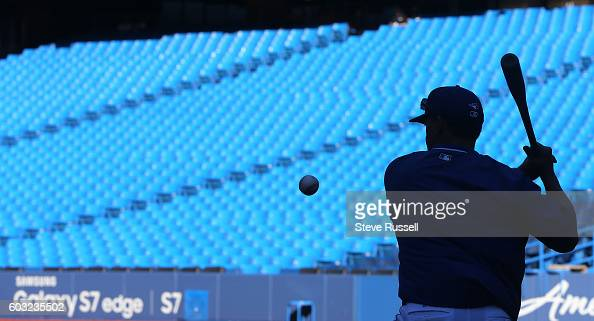 TORONTO ON SEPTEMBER 12 Toronto Blue Jays third base coach Luis Rivera hits grounds during batting practice as the Toronto Blue Jays play the Tampa...