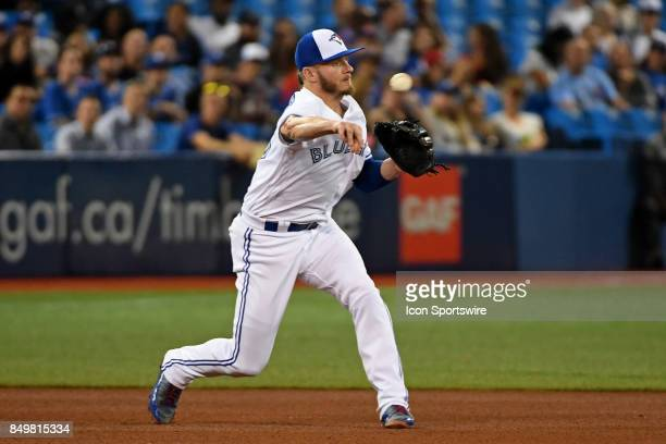Toronto Blue Jays Third base Josh Donaldson throws over to first base during the regular season MLB game between the Kansas City Royals and Toronto...