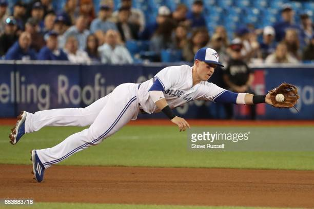 TORONTO ON MAY 15 Toronto Blue Jays third baseman Chris Coghlan makes a diving catch on a Adonis Garcia hit in the fourth inning as the Toronto Blue...