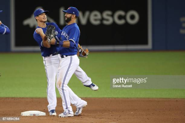TORONTO APRIL 29 Toronto Blue Jays third baseman Darwin Barney and Toronto Blue Jays right fielder Jose Bautista celebrate as the Toronto Blue Jays...