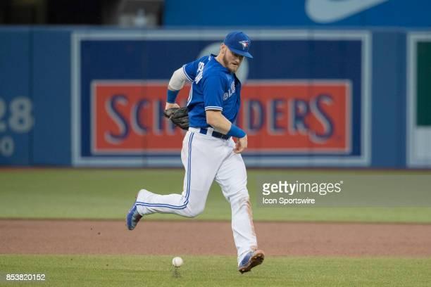 Toronto Blue Jays Third baseman Josh Donaldson bobbles a ball during the regular season MLB game between the New York Yankees and the Toronto Blue...