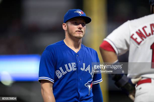 Toronto Blue Jays third baseman Josh Donaldson chats with Cleveland Indians designated hitter Edwin Encarnacion during the fifth inning of the Major...