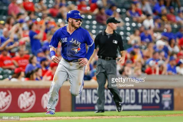 Toronto Blue Jays third baseman Josh Donaldson comes in to score during the 9th inning of the MLB game between the Toronto Blue Jays and Texas...