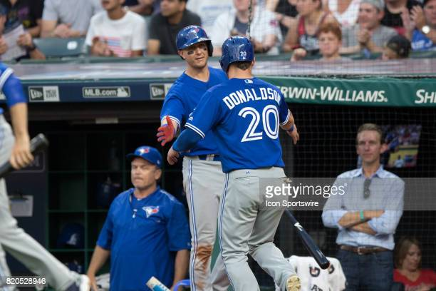 Toronto Blue Jays third baseman Josh Donaldson is congratulated by Toronto Blue Jays shortstop Troy Tulowitzki after scoring a run during the fifth...