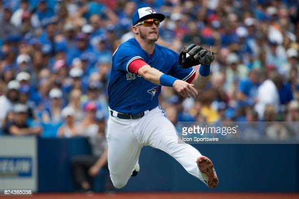 Toronto Blue Jays Third baseman Josh Donaldson makes a leap and catch throwing out the baserunner in the fourth inning during the regular season MLB...
