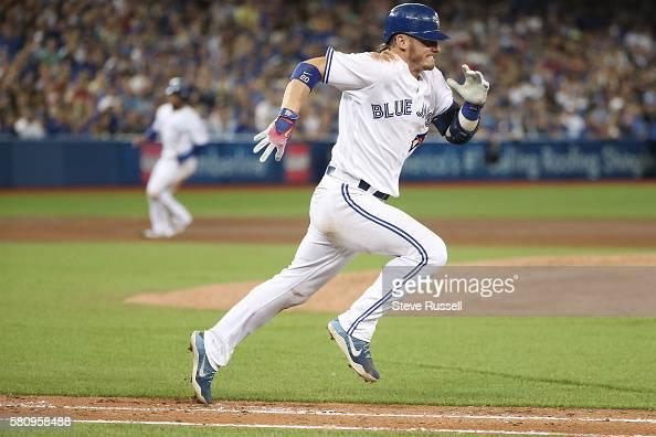 TORONTO ON JULY 25 Toronto Blue Jays third baseman Josh Donaldson sprints to first base as the Toronto Blue Jays play the San Diego Padres at the...