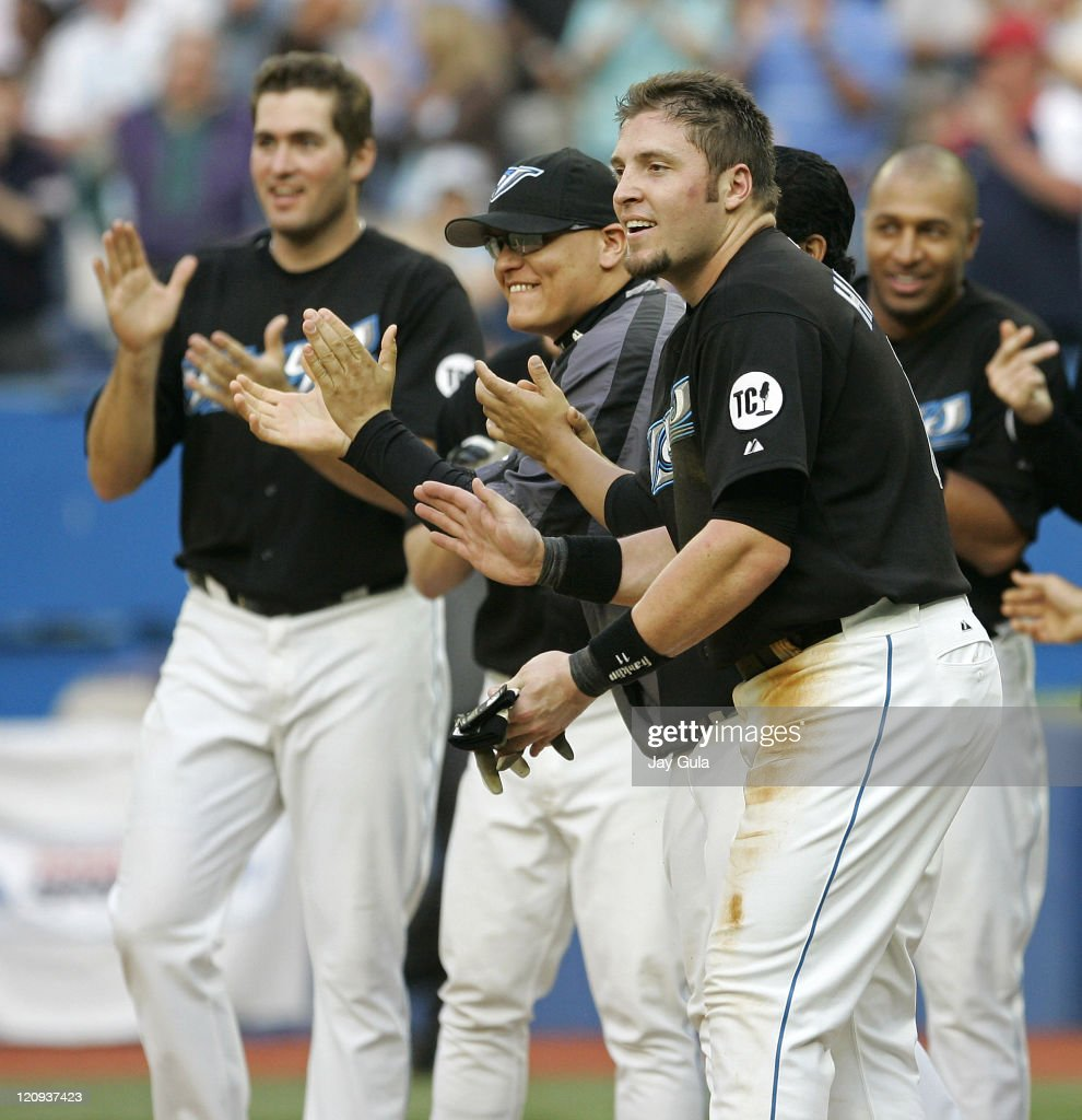 Toronto Blue Jays Troy Glaus Gustavo Chacin Eric Hinske and Vernon Wells await Shea Hillenbrand's arrival at home plate with the winning run after he...