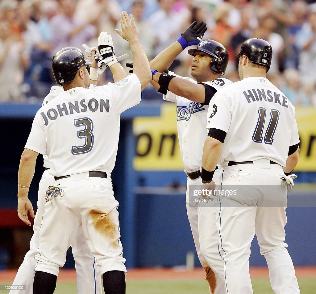 Toronto Blue Jays Vernon Wells is congratulated by teammates Eric Hinske and Reed Johnson after hitting a Grand Slam HR in the 4th inning vs the...