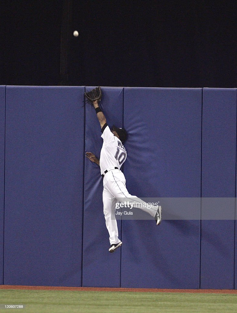 Toronto Blue Jays Vernon Wells leaps up against the centre field wall but cannot come up with this HR off the bat of Boston Red Sox Trot Nixon at...