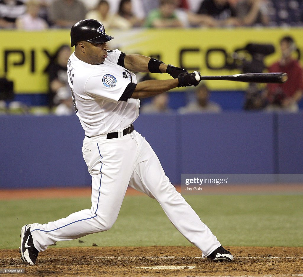 Toronto Blue Jays Vernon Wells slugged his 3rd HR of the game on this swing giving him 15 for the season to lead the Blue Jays to a 85 victory over...