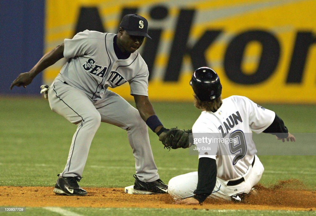 Toronto C Greg Zaun is out trying to steal 2nd base as Mariner SS Yuniesky Betancourt puts on the tag in action at Rogers Centre in Toronto September...
