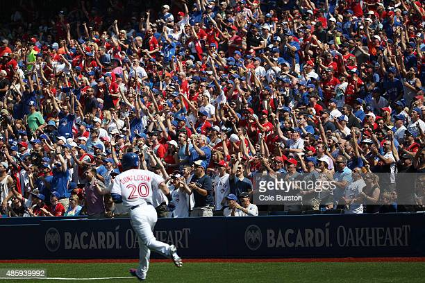 Toronto Canada August 30 Fans cheer on their feet as Toronto Blue Jays third baseman Josh Donaldson runs the bases from his solo homerun in the first...