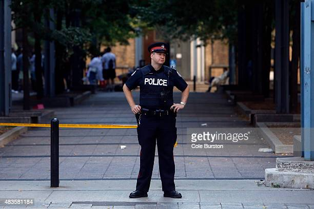 Toronto Canada August 9 Police officers work to keep control of the scene of a shooting outside the Marriott at Dundas and Bay street on August 9...
