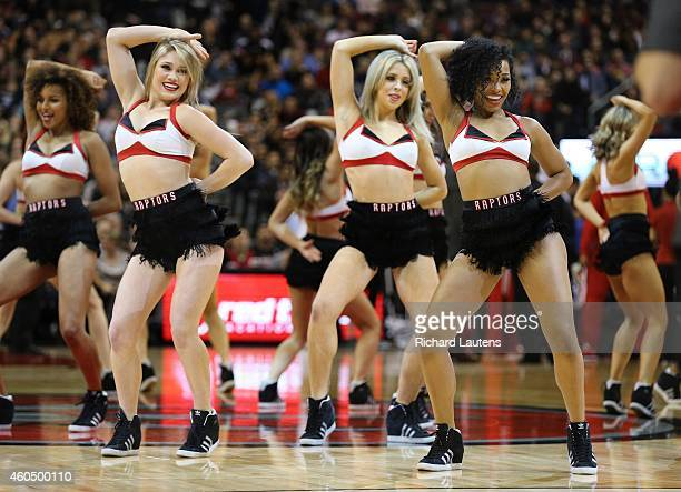 Toronto Canada December 12 In first half action The Raptors Dance pack do their thing during a break The Toronto Raptors played the Indiana Pacer at...