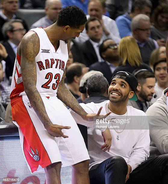Toronto Canada February 11 In first half action Drake chats with Toronto Raptors guard Louis Williams as Williams waits to hit the court The Toronto...