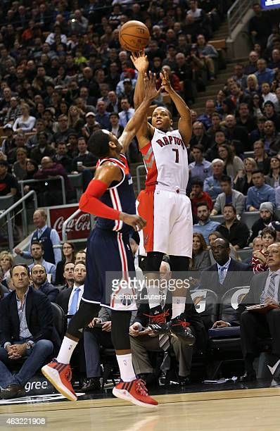 Toronto Canada February 11 In second half action Toronto Raptors guard Kyle Lowry shoots a 3 over Washington Wizards guard John Wall The Toronto...