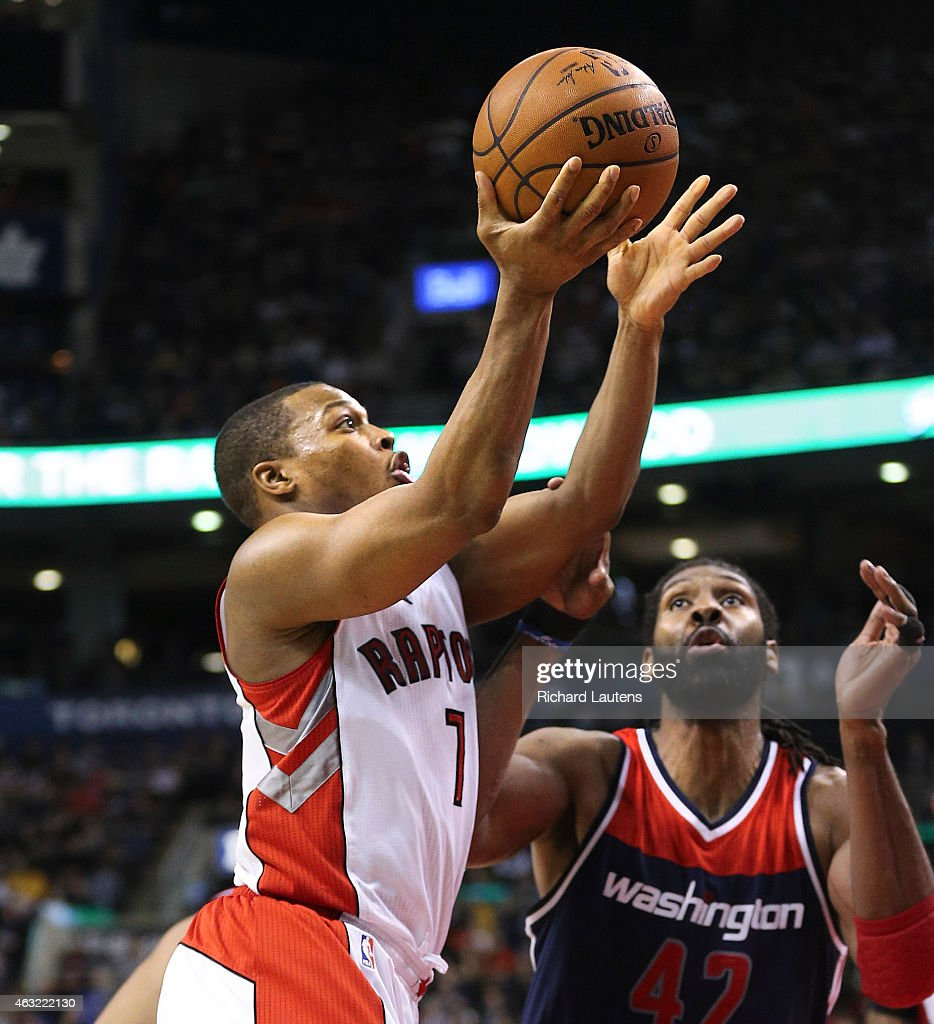 Toronto, Canada - February 11 - In second half action, Toronto Raptors guard <a gi-track='captionPersonalityLinkClicked' href=/galleries/search?phrase=Kyle+Lowry&family=editorial&specificpeople=714625 ng-click='$event.stopPropagation()'>Kyle Lowry</a> (7) battles Washington Wizards forward <a gi-track='captionPersonalityLinkClicked' href=/galleries/search?phrase=Nene+Hilario+-+Basketball+Player&family=editorial&specificpeople=4250456 ng-click='$event.stopPropagation()'>Nene Hilario</a> (42) but ended up on his back. The Toronto Raptors beat the Washington Wizards 95-93 at the Air Canada Centre in Toronto. February 11, 2015