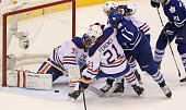 Toronto Canada February 7 In first period action it's a melee late in the period but Edmonton Oilers goalie Viktor Fasth manages to keep the puck out...