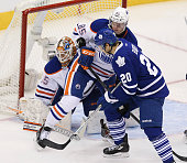 Toronto Canada February 7 In first period action Toronto Maple Leafs left wing David Booth creates a log jam in front of Edmonton Oilers goalie...