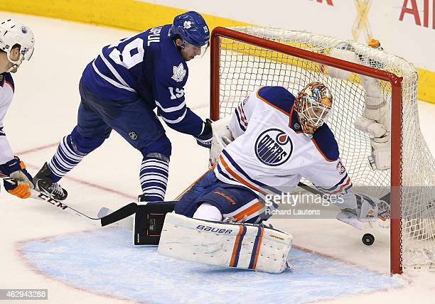 Toronto Canada February 7 In second period action Edmonton Oilers goalie Viktor Fasth reaches back and Toronto Maple Leafs right wing Joffrey Lupul...