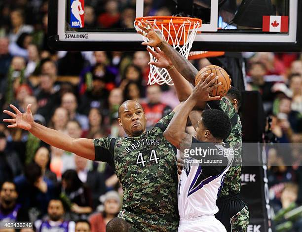 Toronto Canada January 28 In first half action Toronto Raptors center Chuck Hayes plays some big D against Sacramento Kings forward Rudy Gay The...