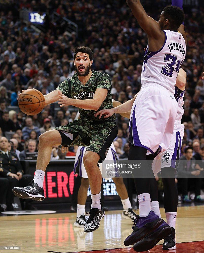 Toronto Canada January 28 In first half action Toronto Raptors guard Greivis Vasquez with the interesting pass around Sacramento Kings forward Jason...