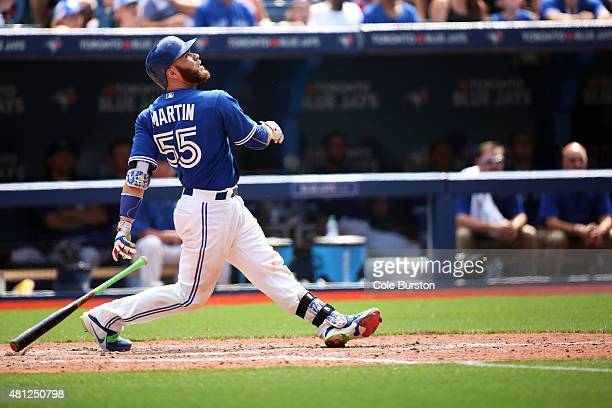 Toronto Canada July 18 Toronto Blue Jays catcher Russell Martin follows his ball after a hit during MLB action against the Tampa Bay Rays in Toronto...