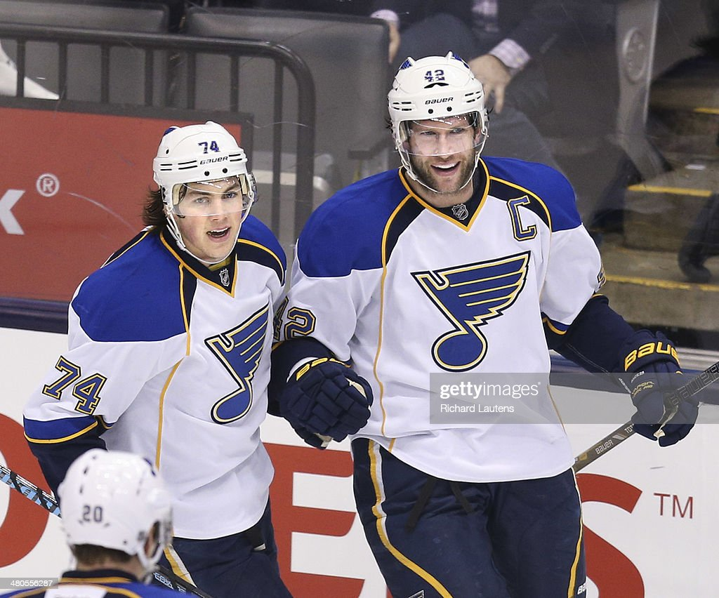 Toronto, Canada - March 25 - In second period action, St. Louis Blues center David Backes (42) celebrates his second goal of the night. To the left is St. Louis Blues right wing T.J. Oshie (74). The Toronto Maple Leafs took on the St. Louis Blues at the Air Canada Centre in Toronto on Tuesday. March 25, 2014