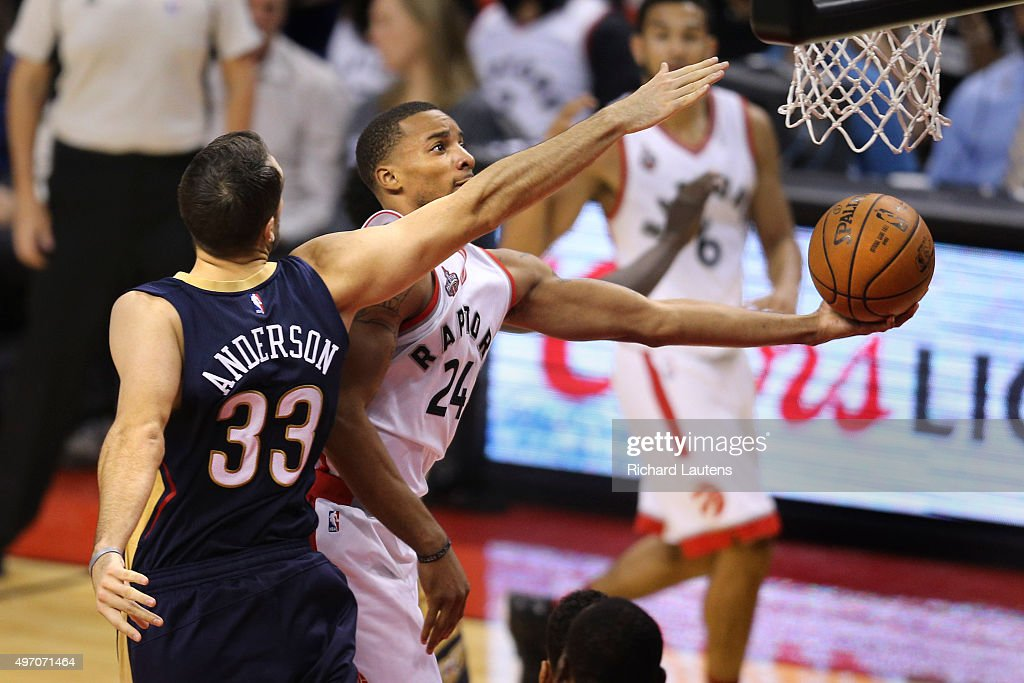 Toronto Canada November 13 2015 In second half action Toronto Raptors guard Norman Powell goes for the hoop around New Orleans Pelicans forward Ryan...