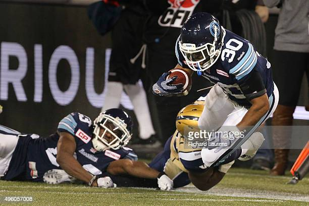 Toronto Canada November 6 2015 In second half action Toronto Argonauts defensive back Travis Hawkins gets tackled by Winnipeg Blue Bombers running...