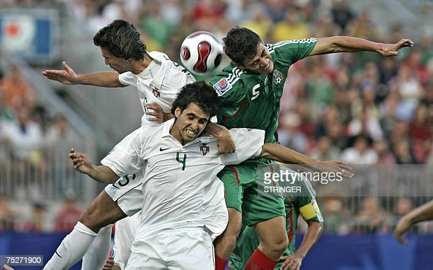 Portugal's Renato Paulo goes for the header with teammate Coelho Nuno and Mexico's Hector Moreno during their match at the FIFA U20 World Cup on 05...