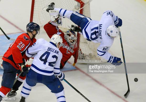 Toronto center Mitch Marner right is upended by Washington goalie Braden Holtby center in the second OT during the Toronto Maple Leafs defeat of the...