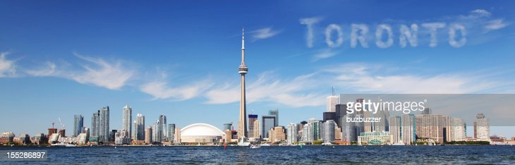 Toronto city panorama, with city name in the clouds : Stock Photo