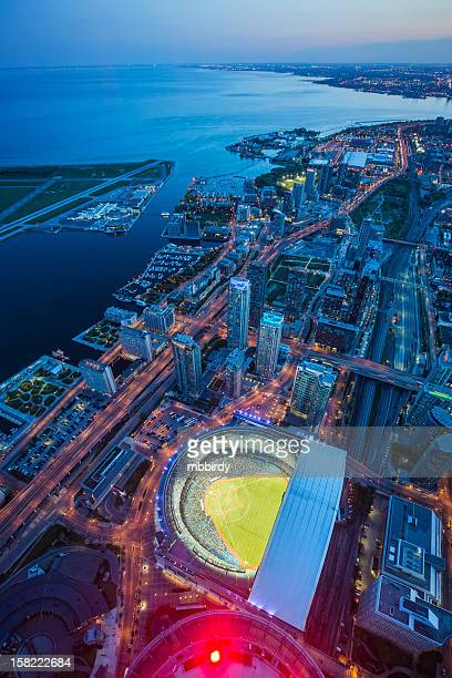 Toronto cityscape with baseball stadium at dusk