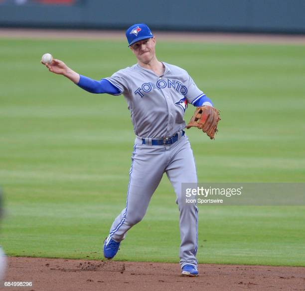 Toronto fBlue Jays second baseman Chris Coghlan throws to first base during a game between the Atlanta Braves and Toronto Blue Jays on May 18 2017 at...