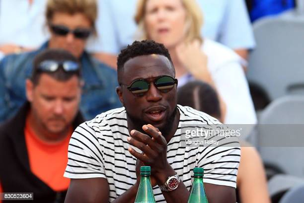 Toronto FC and USA soccer player Jozy Altidore watches Sloane Stephens of the United States play against Lucie Safarova of Czech Republic on during...