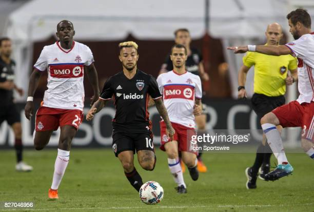 Toronto FC defender Chris Mavinga and forward Sebastian Giovinco chase after DC United midfielder Luciano Acosta during a MLS match between DC United...