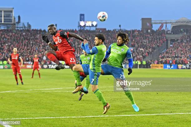 Toronto FC defender Chris Mavinga fights for the ball with Seattle Sounders midfielder Cristian Roldan and defender Roman Torres during the MLS CUP...