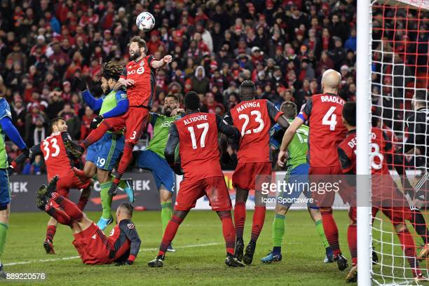 Toronto FC Defender Drew Moor and Seattle Sounders Defender Roman Torres go up to head an incoming corner kick during the MLS CUP Finals between the...