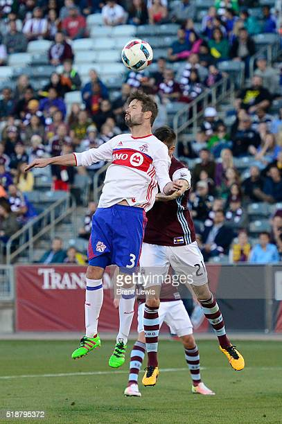 Toronto FC defender Drew Moor goes for a header while Colorado Rapids forward Luis Solignac is late on the jump during the first half at Dick's...