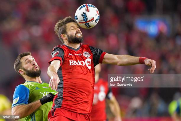 Toronto FC Defender Drew Moor heads the ball as Seattle Sounders Forward Will Bruin challenges during the MLS Cup Final played between the Seattle...
