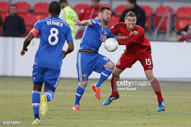 TORONTO ON MAY 13 Toronto FC defender Eriq Zavaleta undresses Jack McInerney as Toronto FC plays Montreal Impact in the SemiFinal of the Amway...